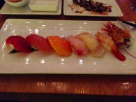 Sushi in Dim Light of Bamboo