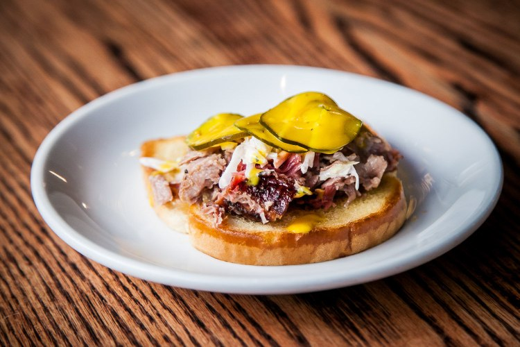 Carolina Clamshell with Carolina Chopped Pork on White Bread with Slaw, Carolina Gold Sauce and Pickles ($3 each)