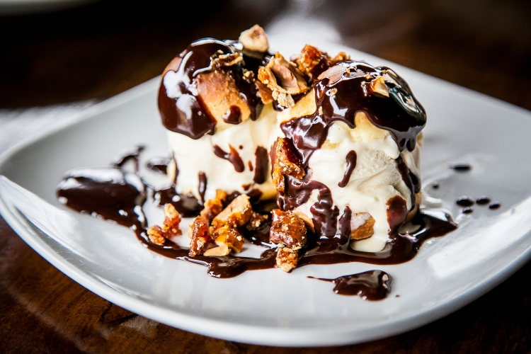 Maker's Mark whisky ice cream profiteroles with chocolate sauce and candied hazelnuts