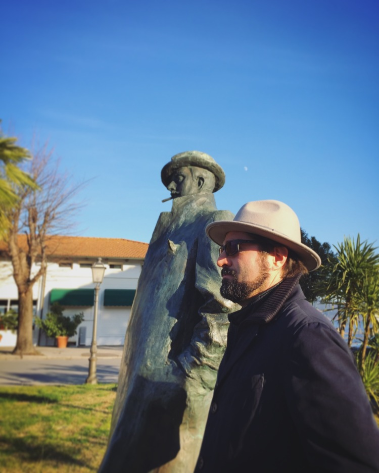 Paolo standing aside Puccini Statue