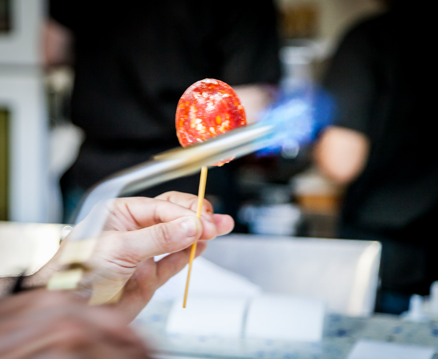 Chef José Firing Xupa-Xup Cantimpalo Chorizo-stuffed Goat Cheese and Membrillo Lolli-pop