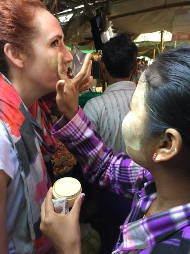 Burmese Woman Applying Thanaka in Market of Bagan