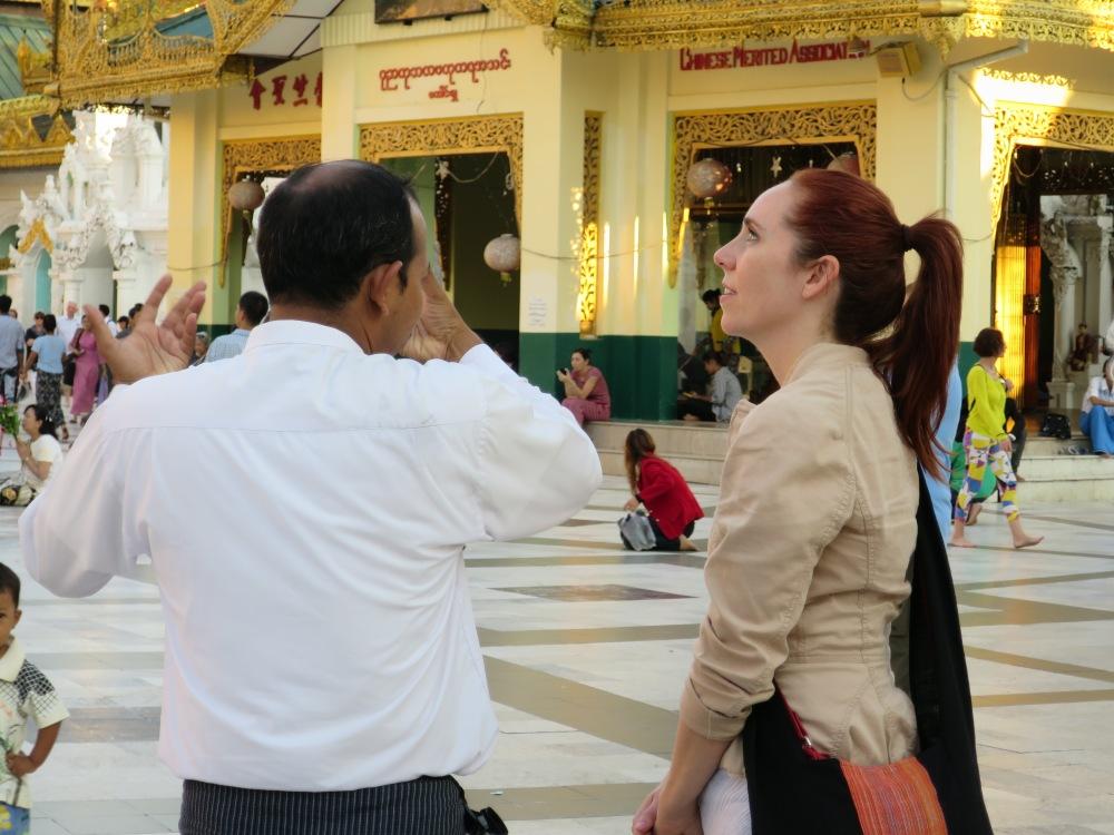 Guide Federico explains belief of Burmese in gold offerings Shwedagon Pagoda