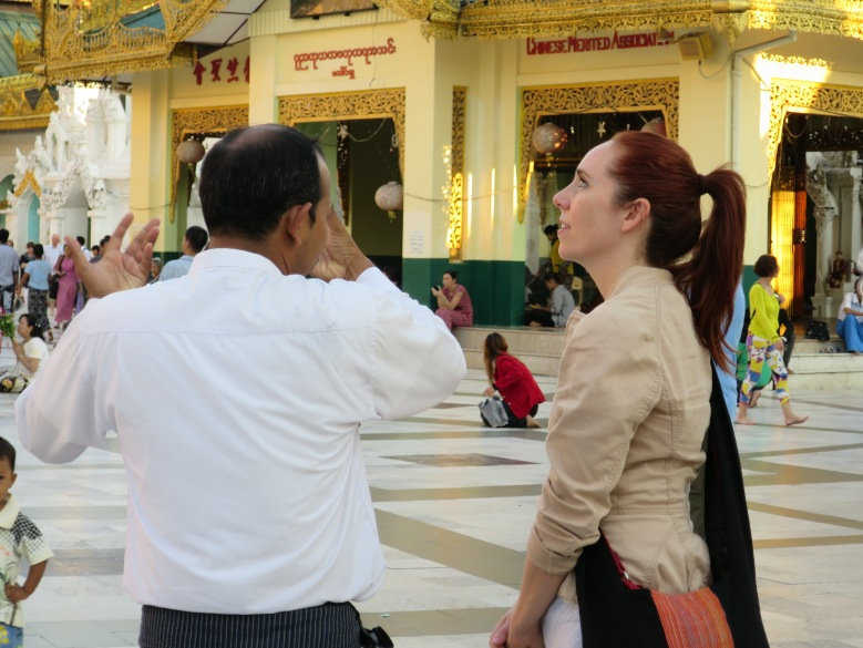 Guide Federico explains belief of Burmese in gold offerings Shwedagon Pagoda